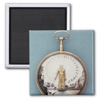 Gold cased bras-en-l'air pocket watch magnet