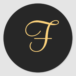 "Gold-colored initial ""F"" on black monogram sticker"