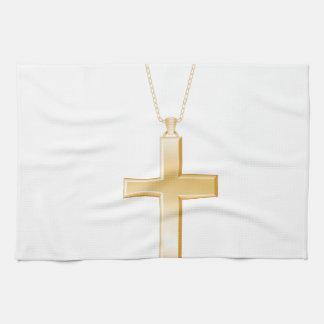 Gold cross and chain, looks like real jewelry. hand towel