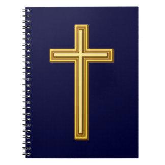Gold Cross on Blue Notebook