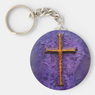 Gold cross on purple keychain