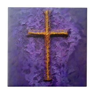 Gold cross on purple ceramic tile