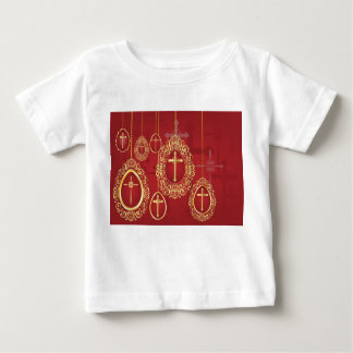 Gold crosses and filigree eggs on red shirts