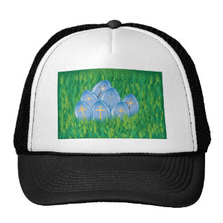 Gold crosses on blue eggs in grass hats