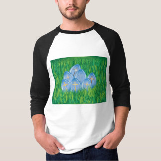 Gold crosses on blue eggs in grass shirt