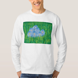 Gold crosses on blue eggs in grass t-shirt