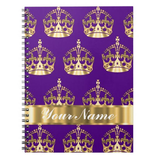 Gold crowns on purple note book