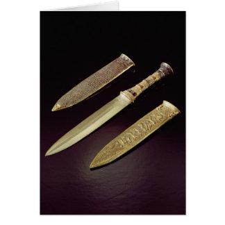Gold dagger and sheath card