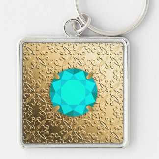 Gold Damask with a faux aquamarine gemstone Keychain