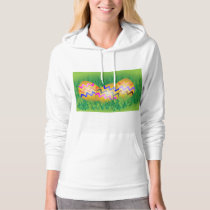 Gold eggs with zig-zag pattern on green grass hoodie