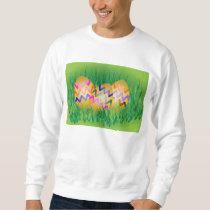 Gold eggs with zig-zag pattern on green grass sweatshirt