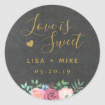 "Gold Floral Love is Sweet Wedding Favor Chalkboard Classic Round Sticker<br><div class=""desc"">Custom-designed wedding favor round stickers/labels featuring ""love is sweet"" in modern hand calligraphy and pink floral bouquet on chalkboard texture background. Personalize with bride and groom's names and wedding date. Apply the stickers/labels on boxes,  bags,  or jars for unique DIY wedding candy favors/gifts.</div>"
