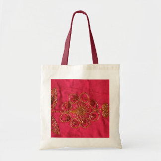 Gold flower on bright pink tote bag