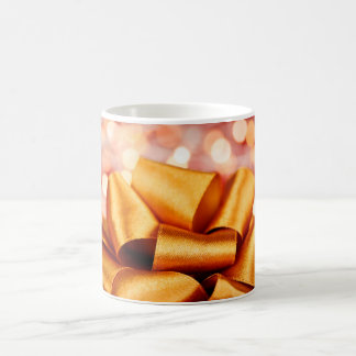 Gold gift bow with festive lights coffee mug