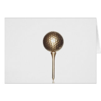 Gold golf ball and tee card