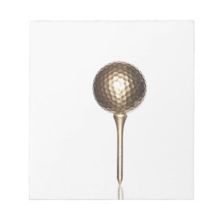 Gold golf ball and tee notepad