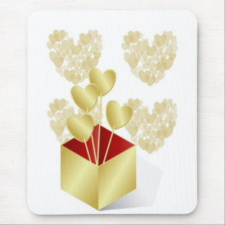 Gold hearts in a gold gift box mouse pad