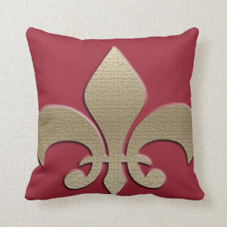 Gold image on a deep red pillow