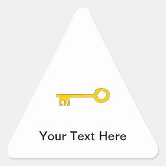 Gold Key on White. Triangle Sticker