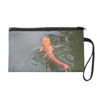 gold koi in pond with cichlids fish image picture wristlet purse