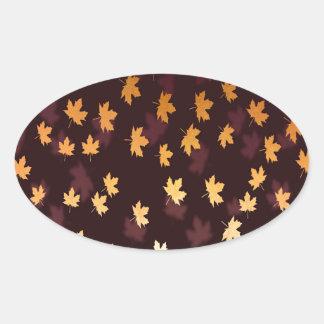 Gold Maple Leaf on dark red Oval Sticker