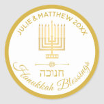 """Gold Menorah Hanukkah Blessings Personalized Classic Round Sticker<br><div class=""""desc"""">Add your name and the year to these HANUKKAH BLESSINGS gold and white Menorah design stickers for your Hanukkah celebration. Hebrew lettering spelling HANUKKAH and a modern style original artwork gold Menorah makes these round holiday stickers a lovely addition to your Chanukah party planning. All gold tone text can be...</div>"""
