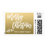 Gold Merry Christmas | Holiday Postage<br><div class='desc'>A perfect choice for your Christmas holiday greetings to your friends and family,  a beautifully,  simple holiday postage design with the words &quot;Merry Christmas with love&quot; written in a trendy white script hand lettered font on a gold background. Design by ELKE CLARKE&#169; Available exclusively at www.zazzle.com/monogramgallery*.</div>
