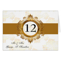 gold monogram table seating card