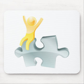 Gold person on jigsaw piece mouse pad