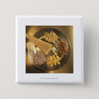 Gold Plate with pasta and grains of wheat Button