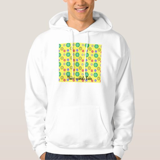 Gold silver red green snowflakes on yellow hoodies