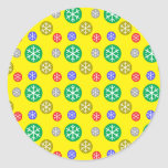 Gold silver red green snowflakes on yellow sticker