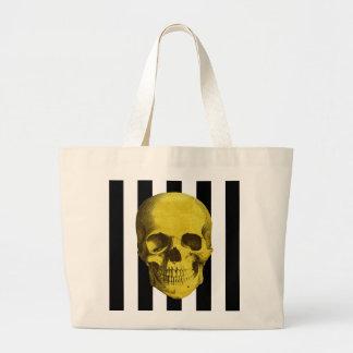 Gold skull on black and white stripes large tote bag