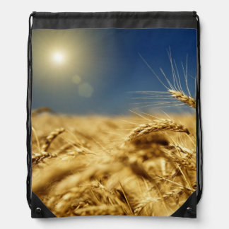 Gold wheat and blue sky with sun drawstring bags