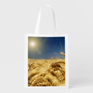 Gold wheat and blue sky with sun reusable grocery bag