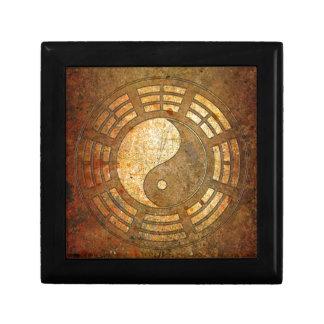 Gold Yin Yang Sign On Stone Background Gift Box