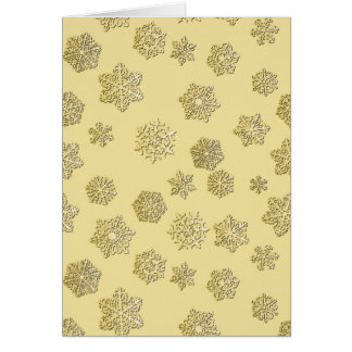 Golden 3-d snowflakes on a gold background card