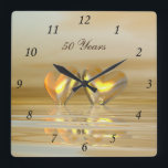 "Golden Anniversary Hearts Square Wall Clock<br><div class=""desc"">An all-golden and yellow 3d scene with golden hearts floating on water. Customizable text says &quot;50 Years&quot;.</div>"