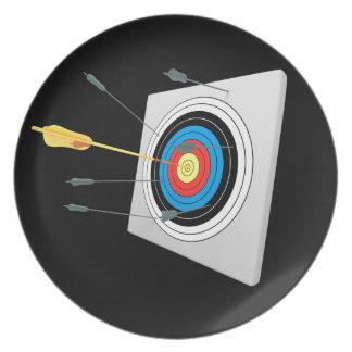 Golden arrow in a target dinner plate