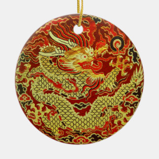 Golden asian dragon embroidered on dark red ceramic ornament