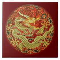 Golden asian dragon embroidered on dark red ceramic tile