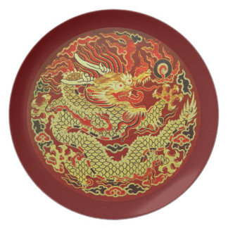 Golden asian dragon embroidered on dark red dinner plate