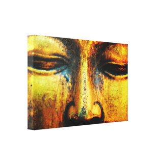 Golden Bronze Statue of the Buddhas Face Canvas Print