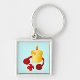 Golden candle with Earmuffs and mittens Keychain