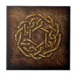 Golden celtic knot on leather ceramic tile