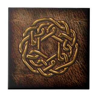 Golden celtic knot on leather tile