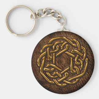Golden celtic ornament on leather key chain