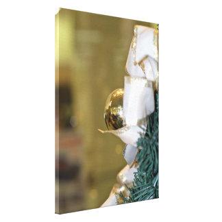 Golden christmas bauble canvas print