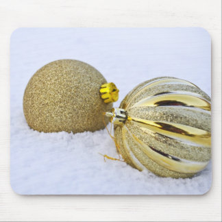 Golden Christmas baubles in snow Mouse Pad