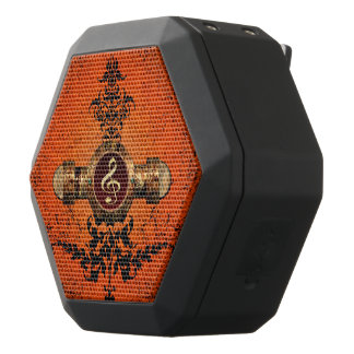 Golden clef on a awesome button black bluetooth speaker